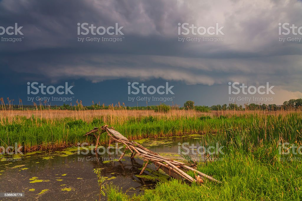 Terrific storm cyclone over the beautiful countryside river stock photo