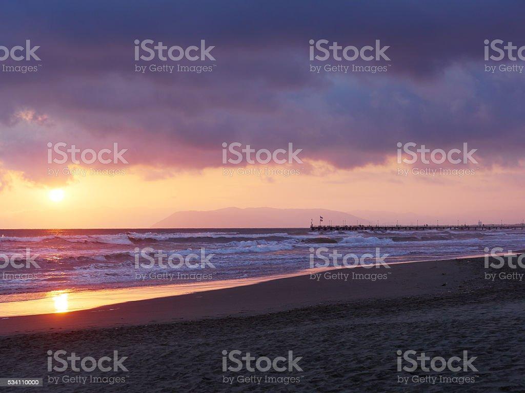 terrific sunset at Forte dei Marmi. Famous pier in Background stock photo