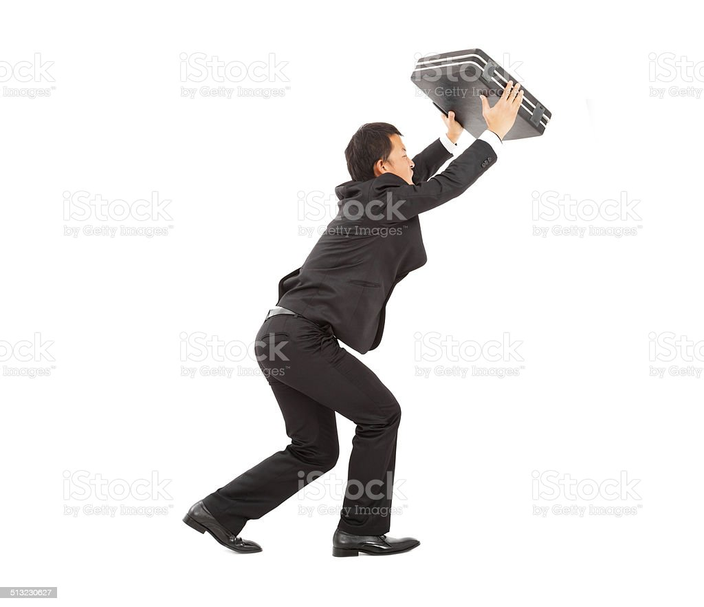 terrified businessman using briefcase to protect. stock photo