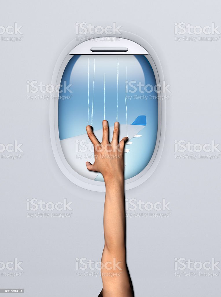 Terrified hand at the window showing a fear of flying stock photo