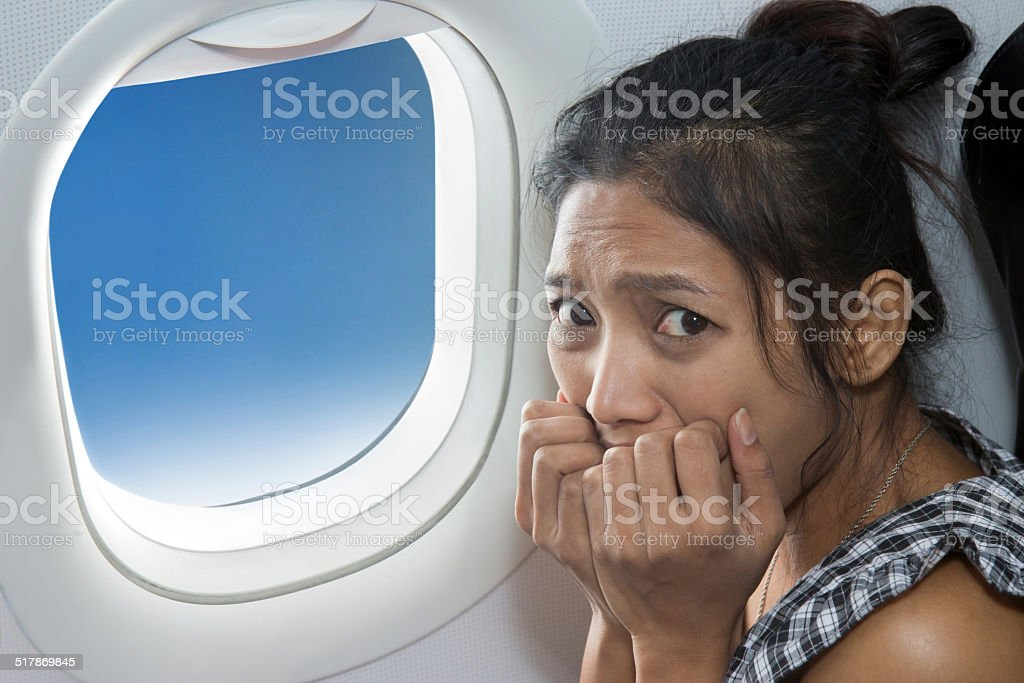 terrified passenger on a plane stock photo