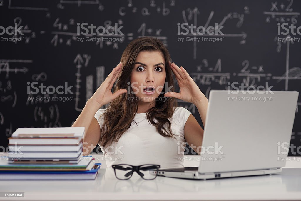 Terrified young woman in classroom royalty-free stock photo