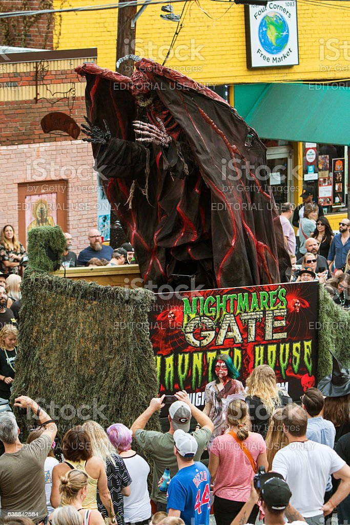 Terrifying Monster Rises Up On Float At Halloween Parade stock photo