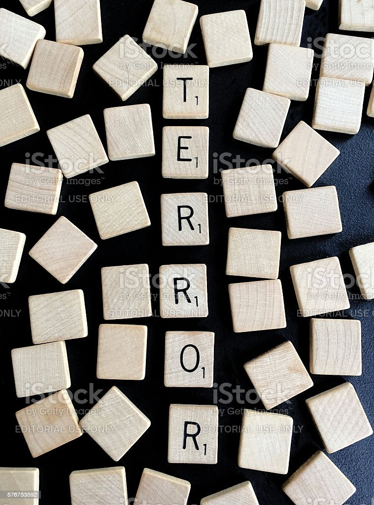 Terror Spelled with Old Scrabble Letters stock photo