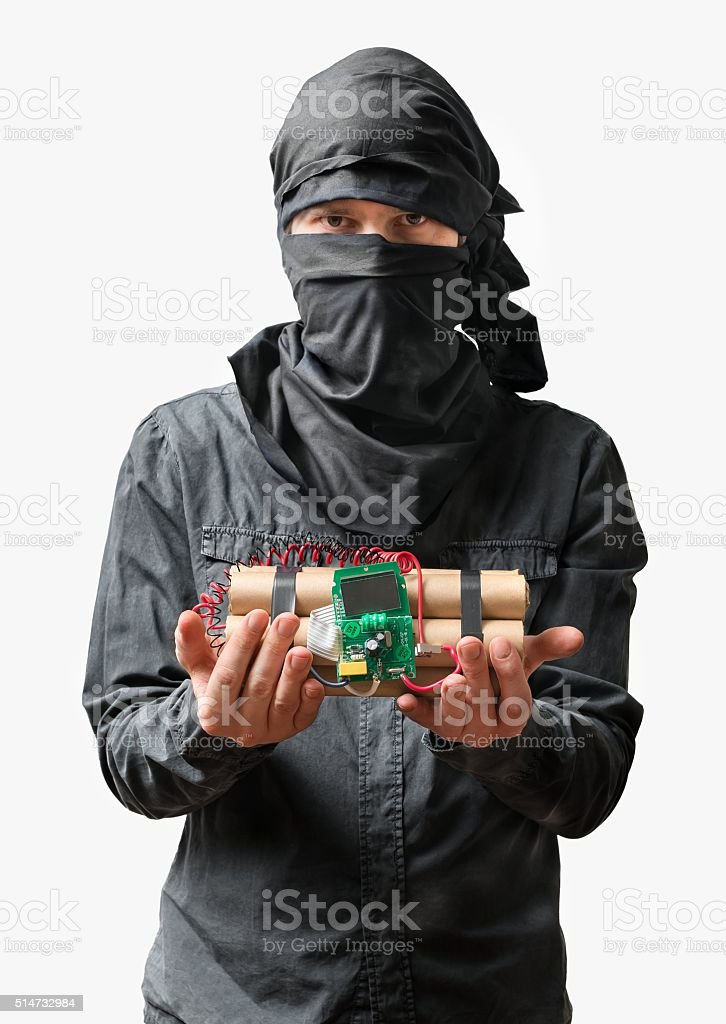 Terrorist holds dynamite bomb in hand. Isolated on white background stock photo