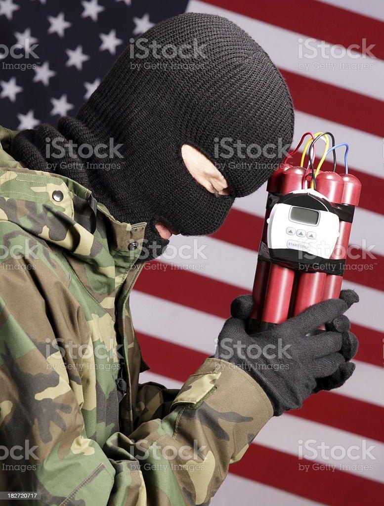 Terrorist in America Prays With Explosives royalty-free stock photo