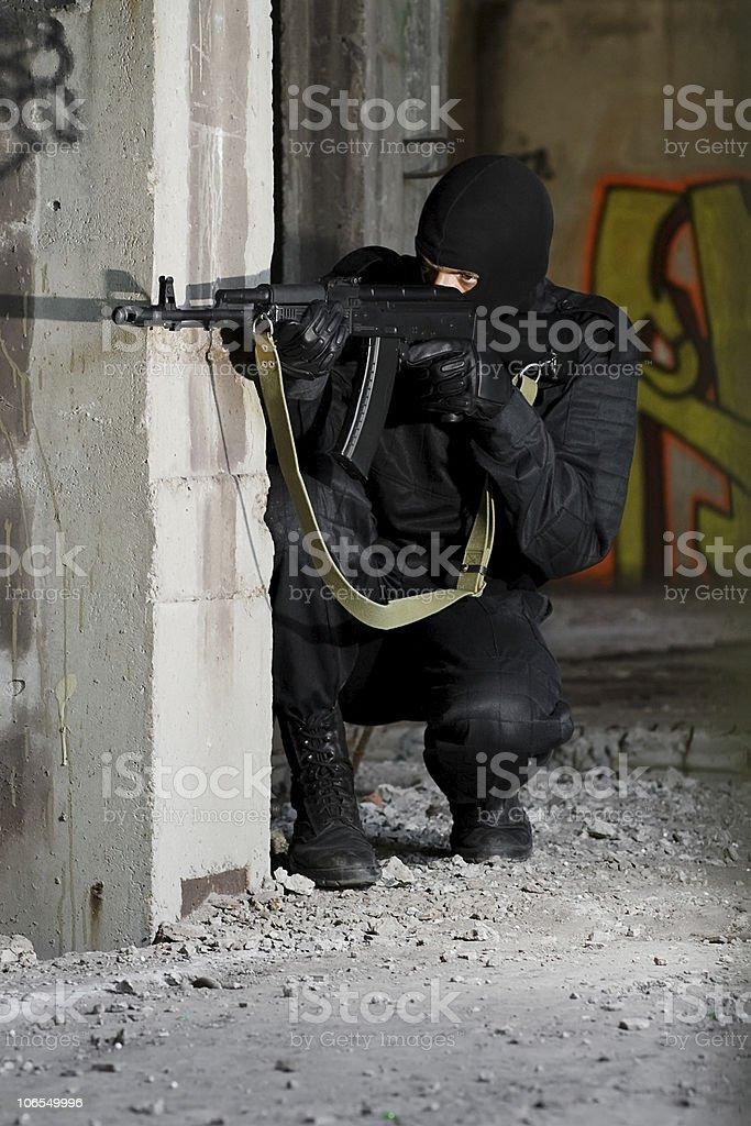 Terrorist in uniform with AK-47 rifle royalty-free stock photo