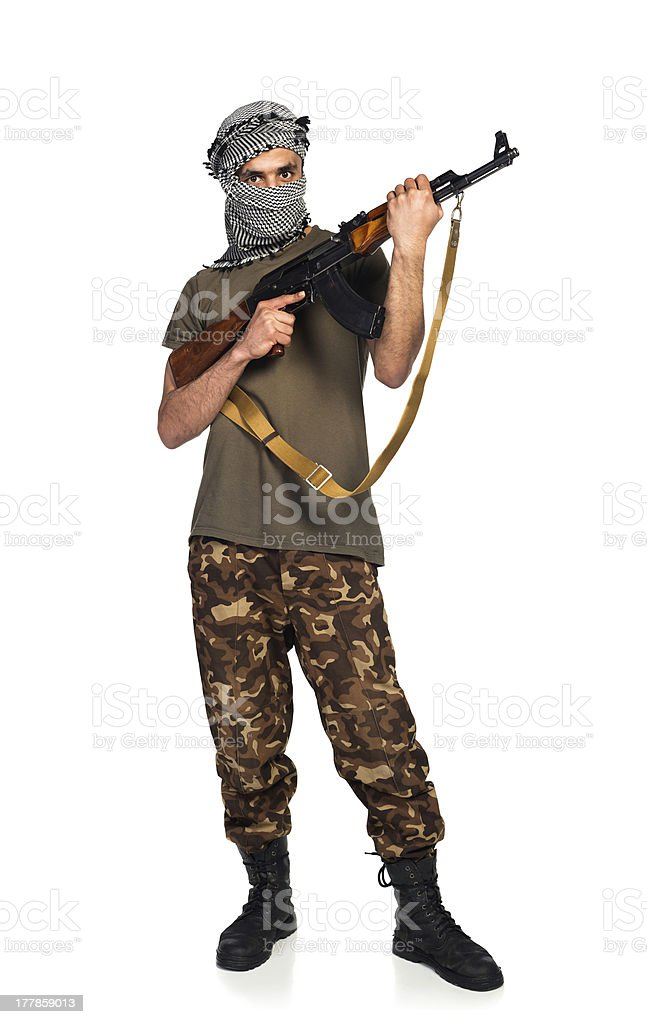 Terrorist with automatic gun on white background stock photo