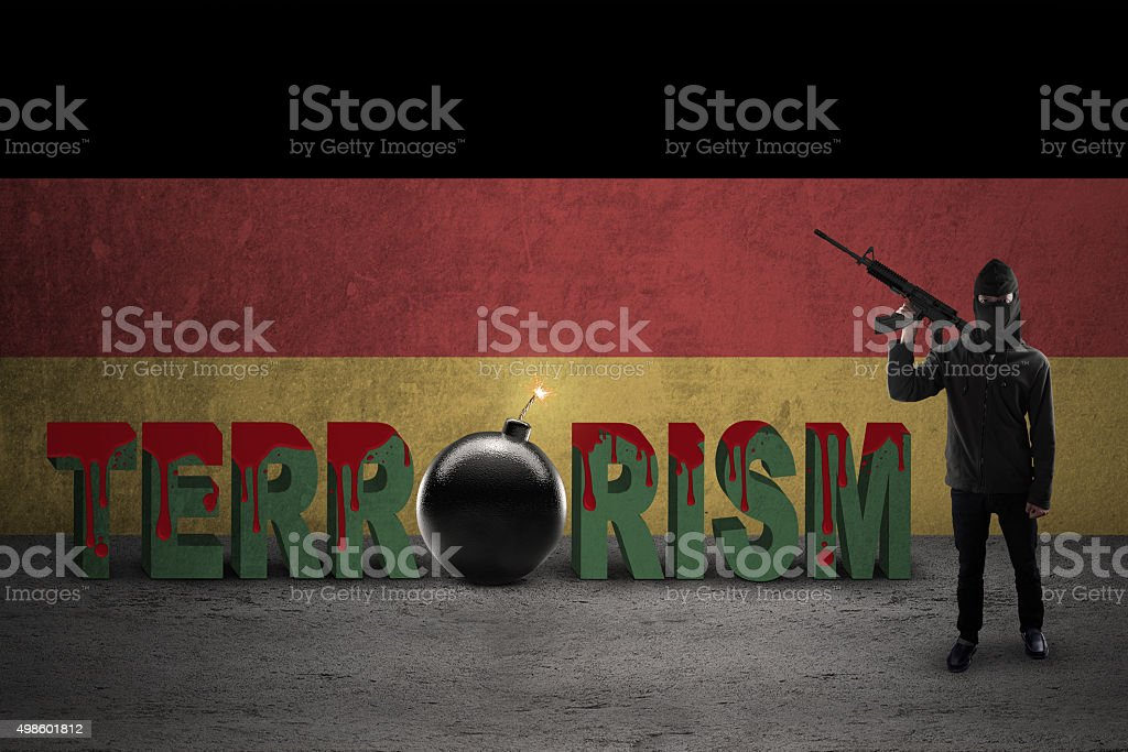 Terrorist with flag of German and terrorism text stock photo