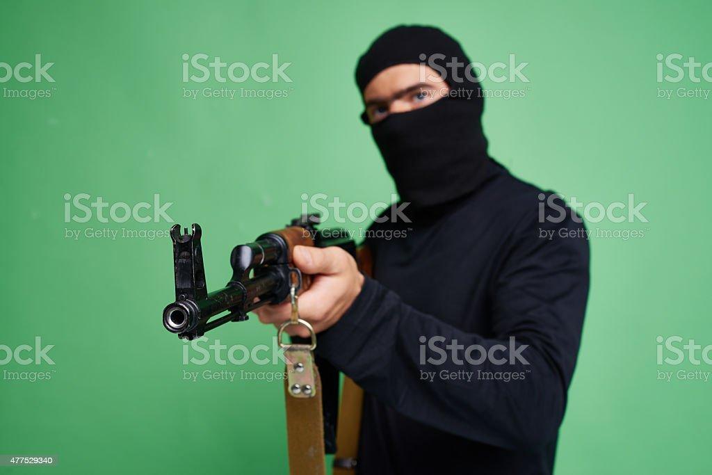Terrorist with Kalashnikov gun stock photo