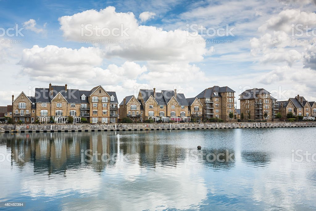 Terrrace houses by a marine dock. stock photo