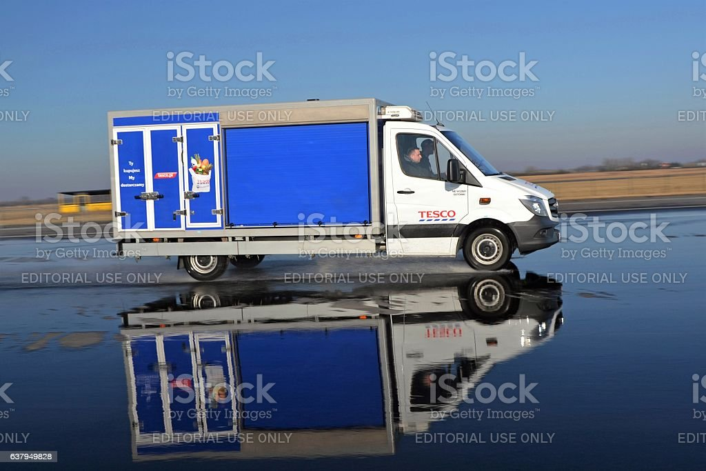 Tesco delivery van in motion stock photo