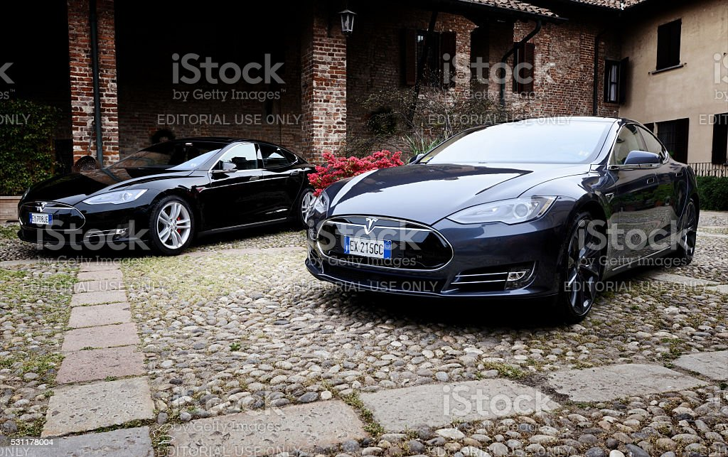 Tesla model S car parked in old stock photo