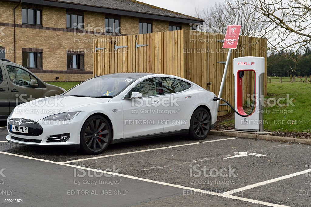 Tesla model S electric car parked at a charging station stock photo