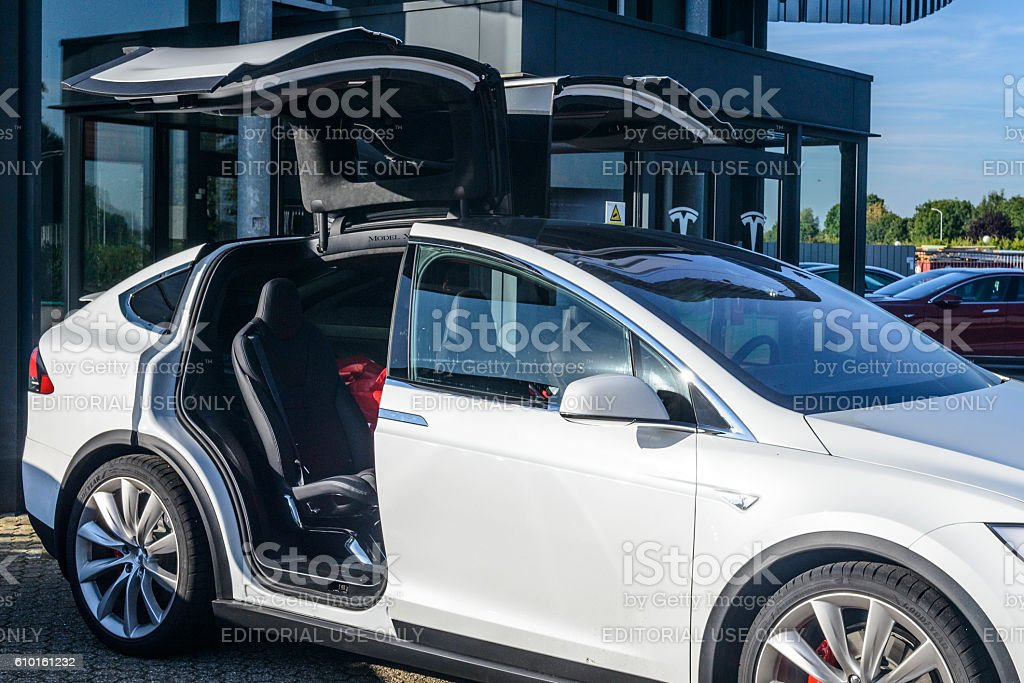 Tesla Model X crossover SUV with open falcon wing doors stock photo