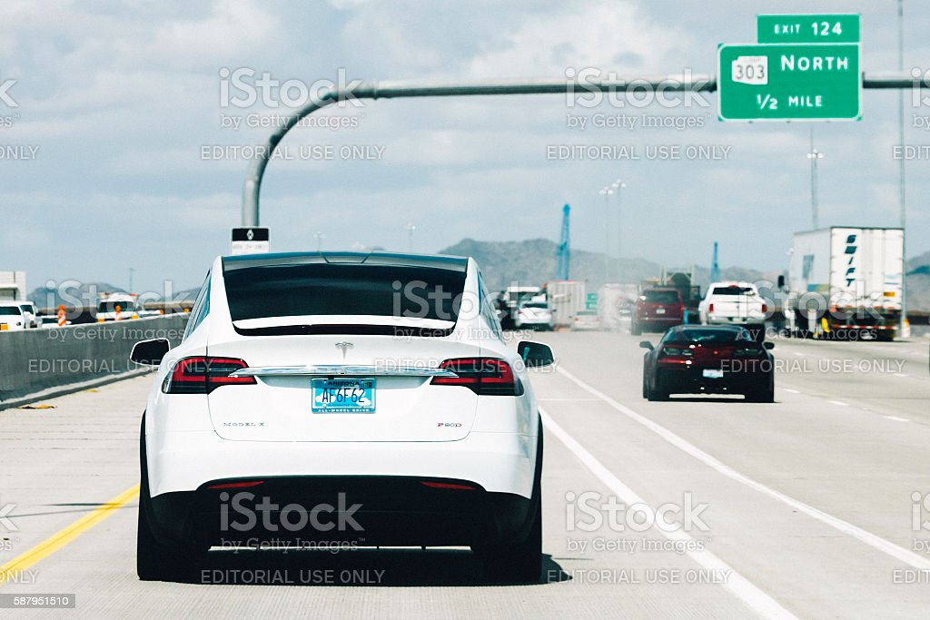 Tesla Model X on the road in Arizona. stock photo
