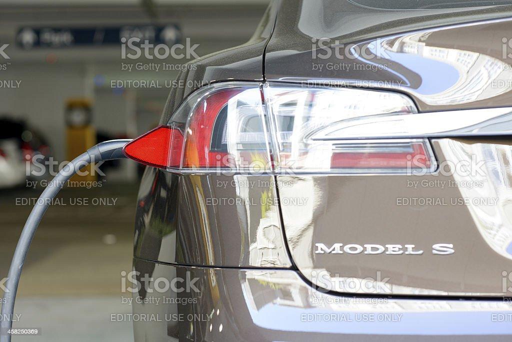A Tesla Motors Model S charging in San Jose, Calif royalty-free stock photo