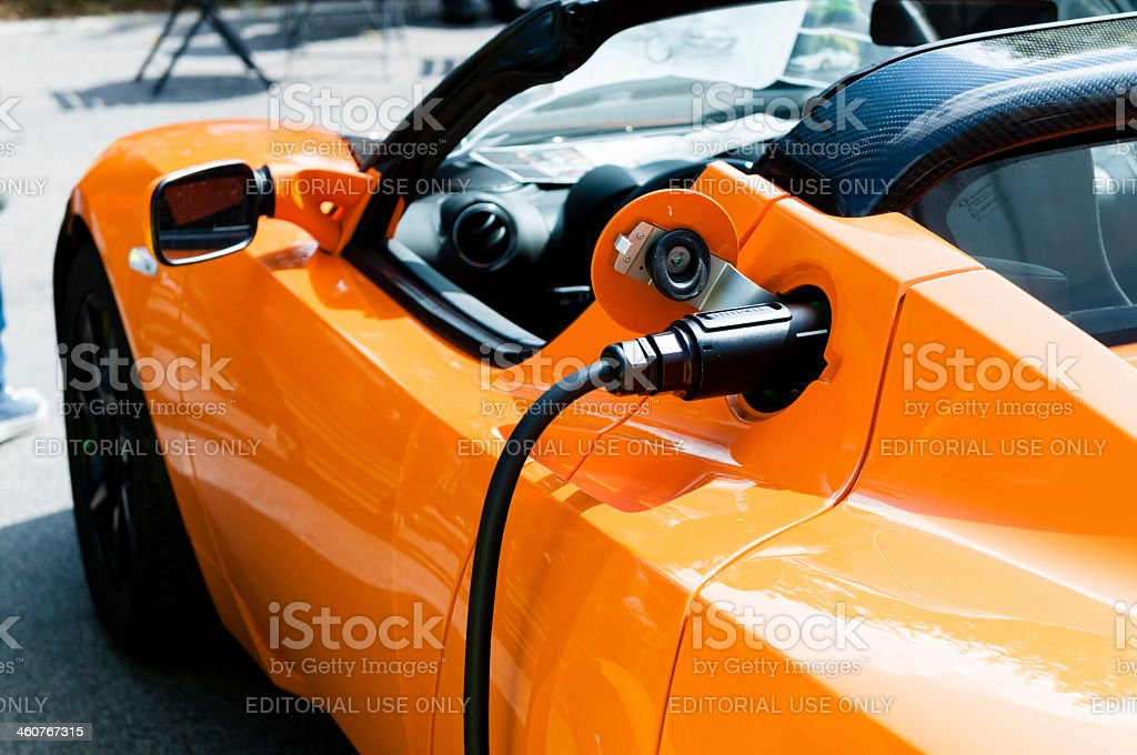 Tesla Roadster Sport gets powered by electricity royalty-free stock photo