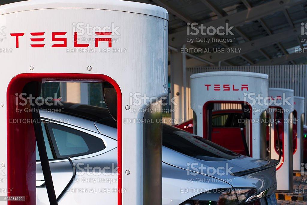 Tesla supercharger parking stock photo