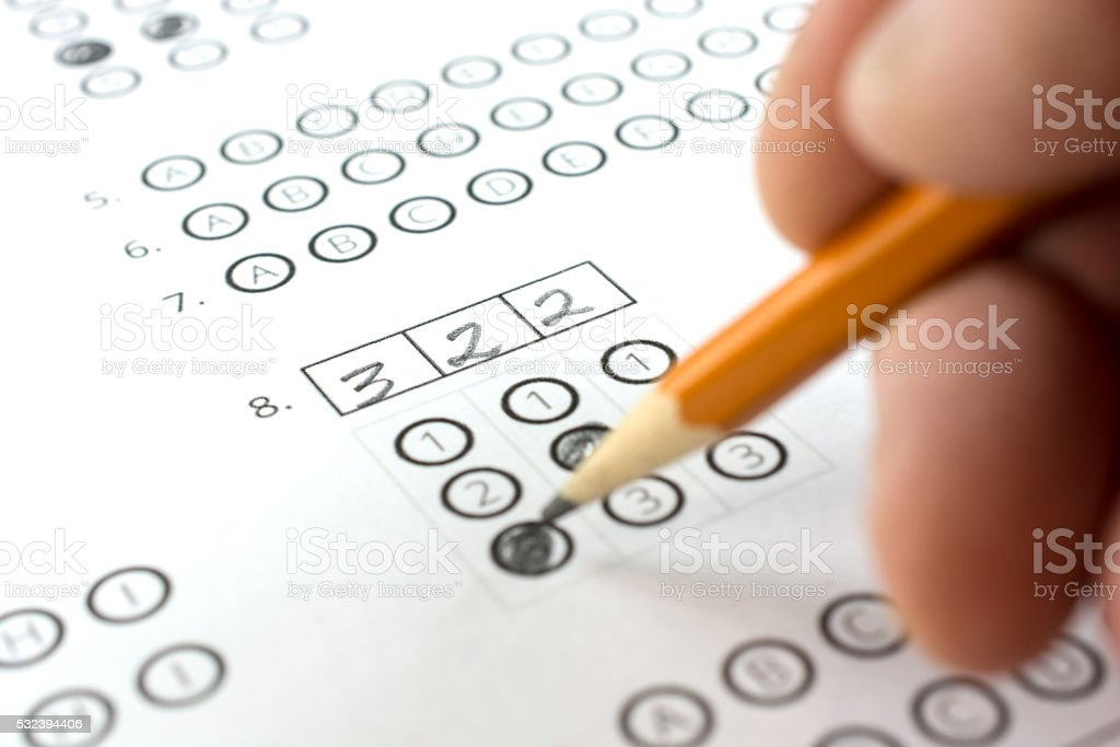 Test and exam answer sheet showing how to fill-in numbers stock photo