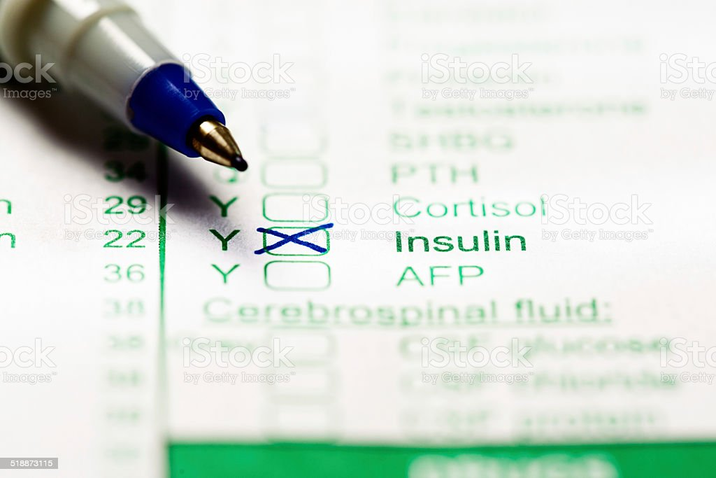 Test for insulin levels marked on medical form. Suspected diabetes? stock photo