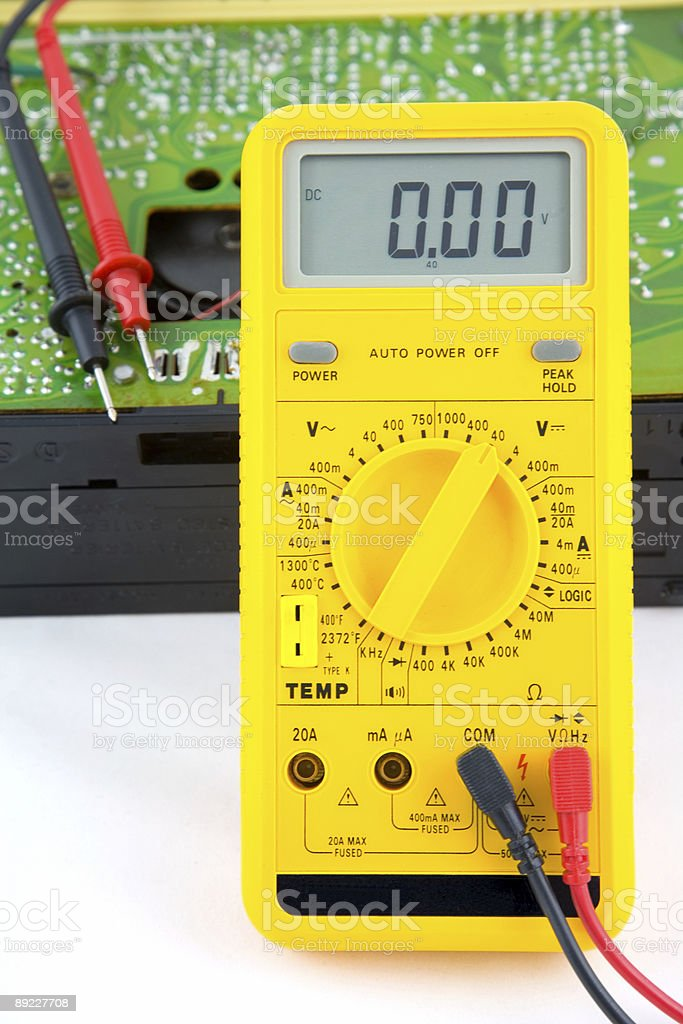 Test meter and opened portable radio stock photo
