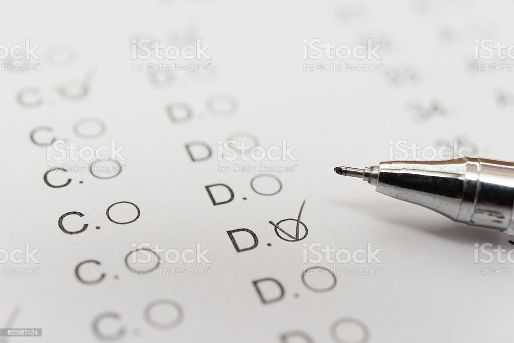 test score sheet with answers and ballpoint close up stock photo