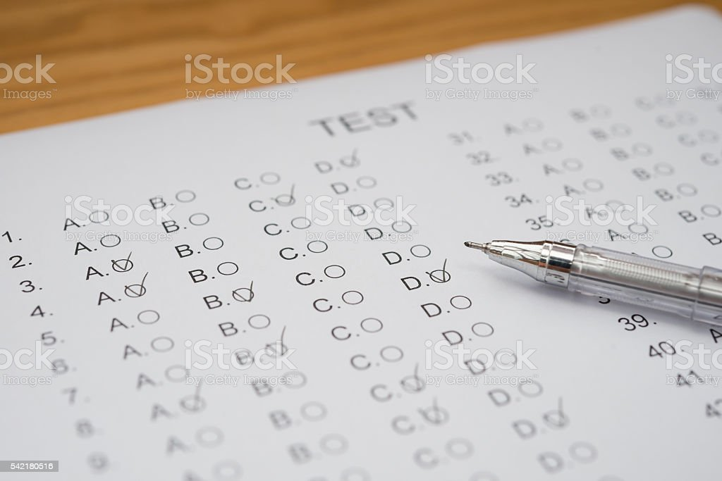 test score sheet with answers and ballpoint stock photo