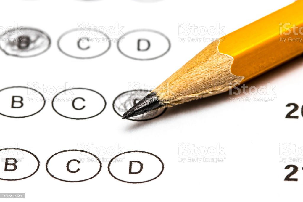 Test score sheet with answers and pencil . Closeup. stock photo