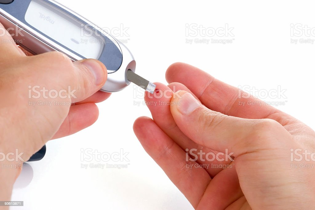 Test to measure blood glucose levels using a glucose meter stock photo