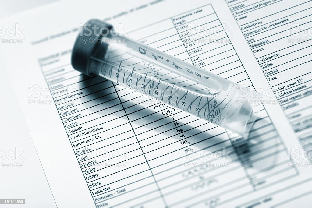 A test tube containing water for analysis on top of document royalty-free stock photo