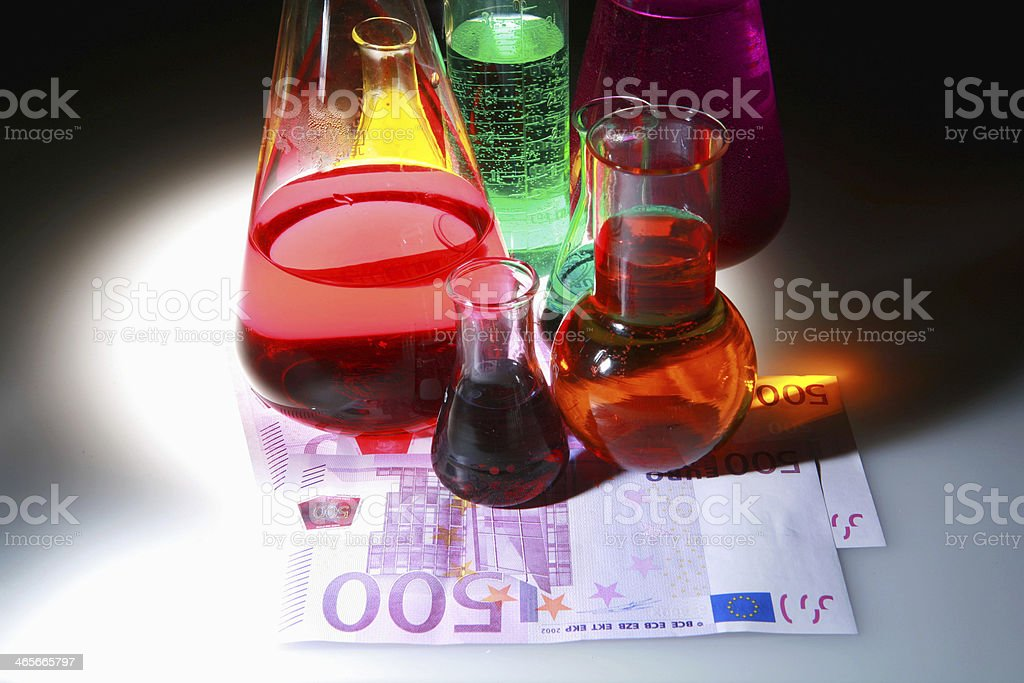 Test tube Scene chemicals pills and money stock photo