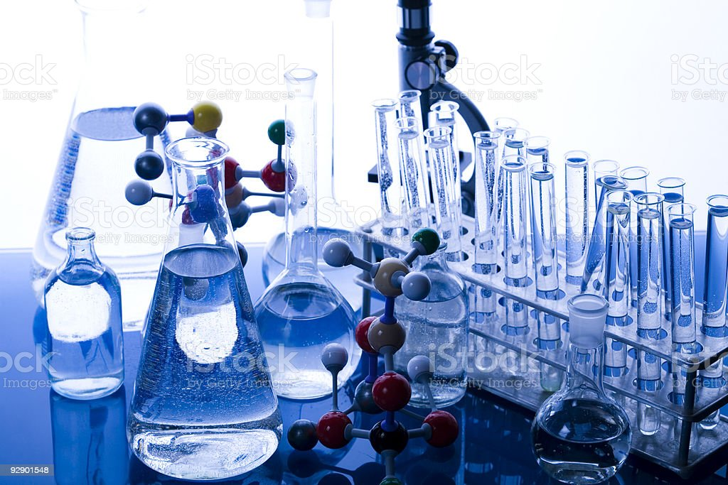 Test tubes and beakers in chemistry lab stock photo