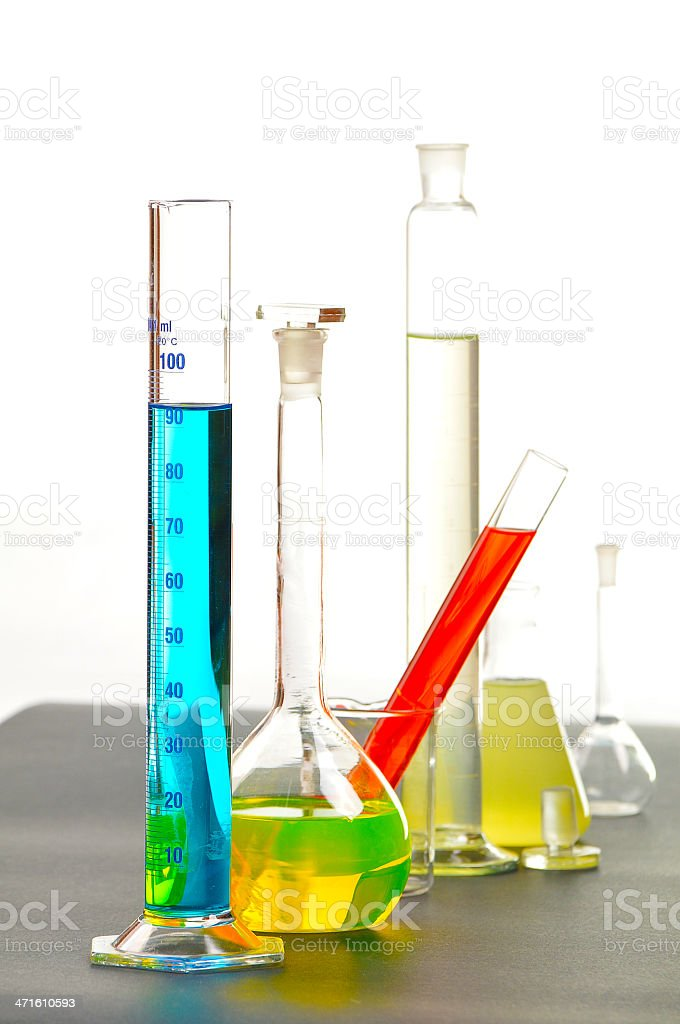 Test tubes and beakers in research laboratory with colorful solutions royalty-free stock photo