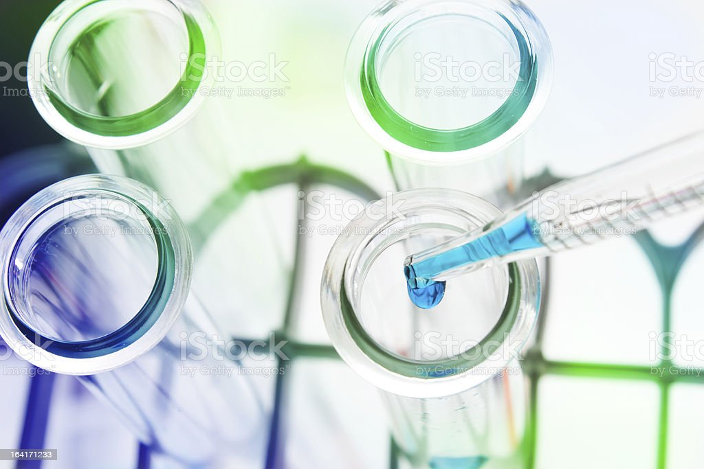 Test tubes closeup on blue background. royalty-free stock photo