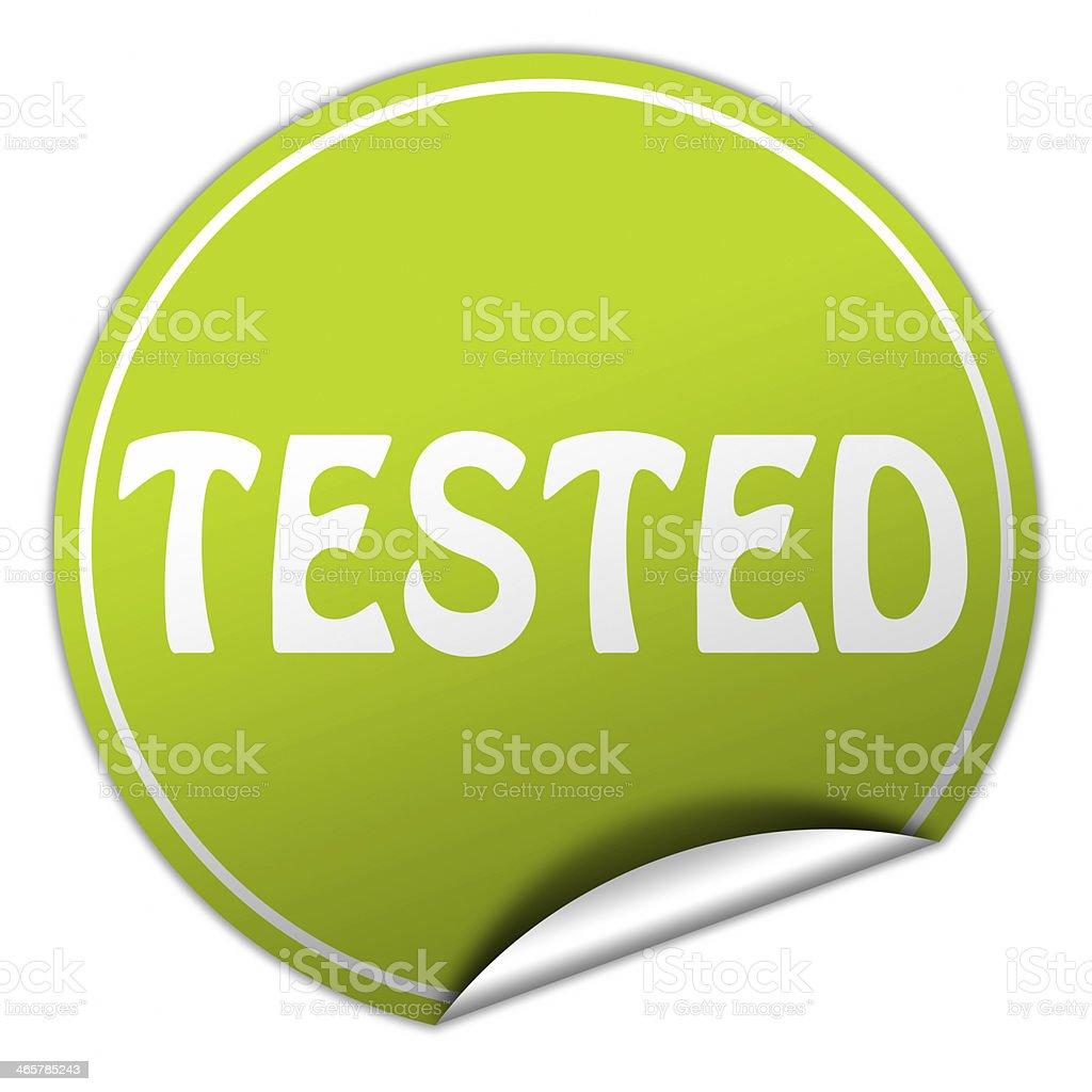 tested round green sticker on white background stock photo