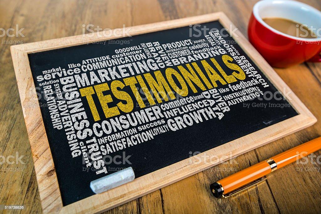 testimonial word cloud on small blackboard stock photo
