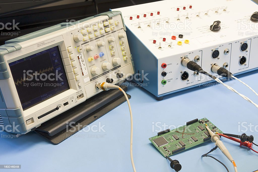 Testing a Circuit Board in an Electronics Lab stock photo