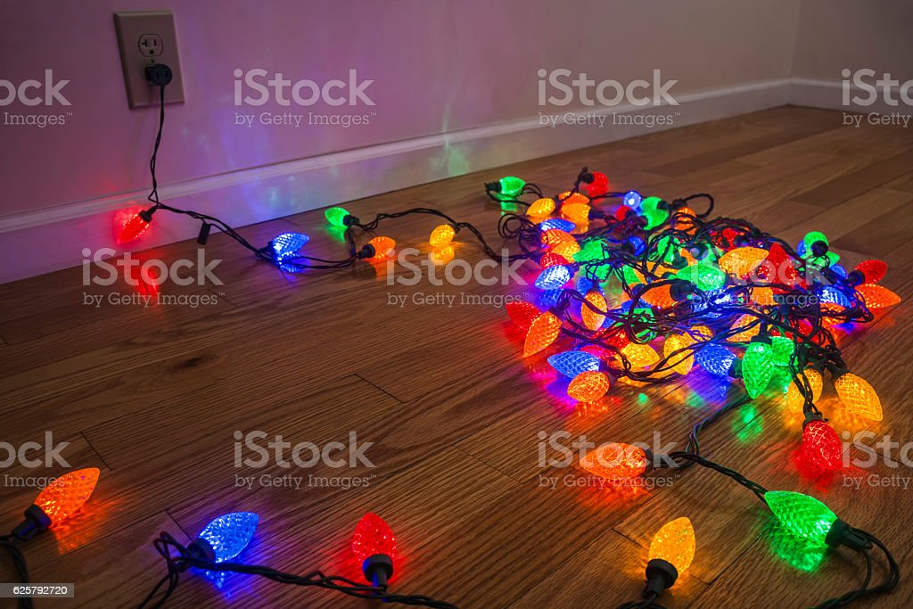 Testing a colorful Christmas lights before they are strung up stock photo