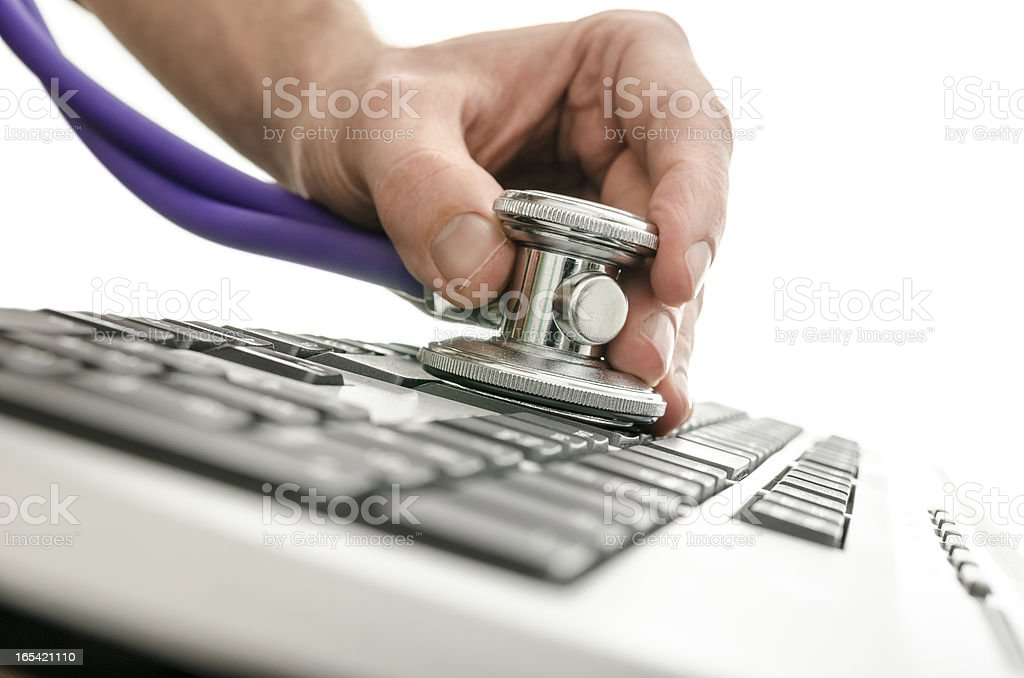 Testing a computer keyboard with stethoscope royalty-free stock photo