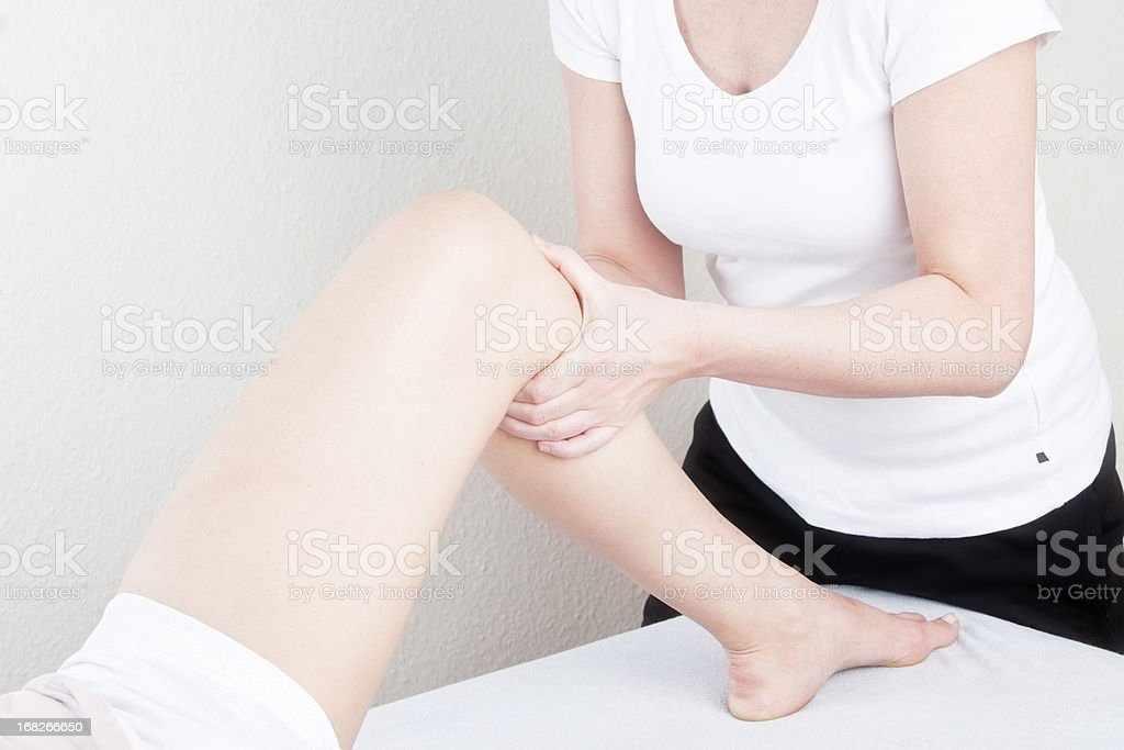 Testing a knee for stability stock photo