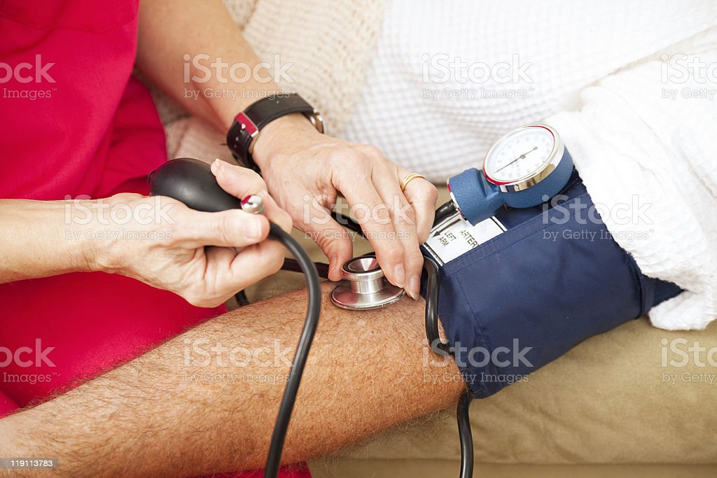 Testing Blood Pressure - Closeup stock photo