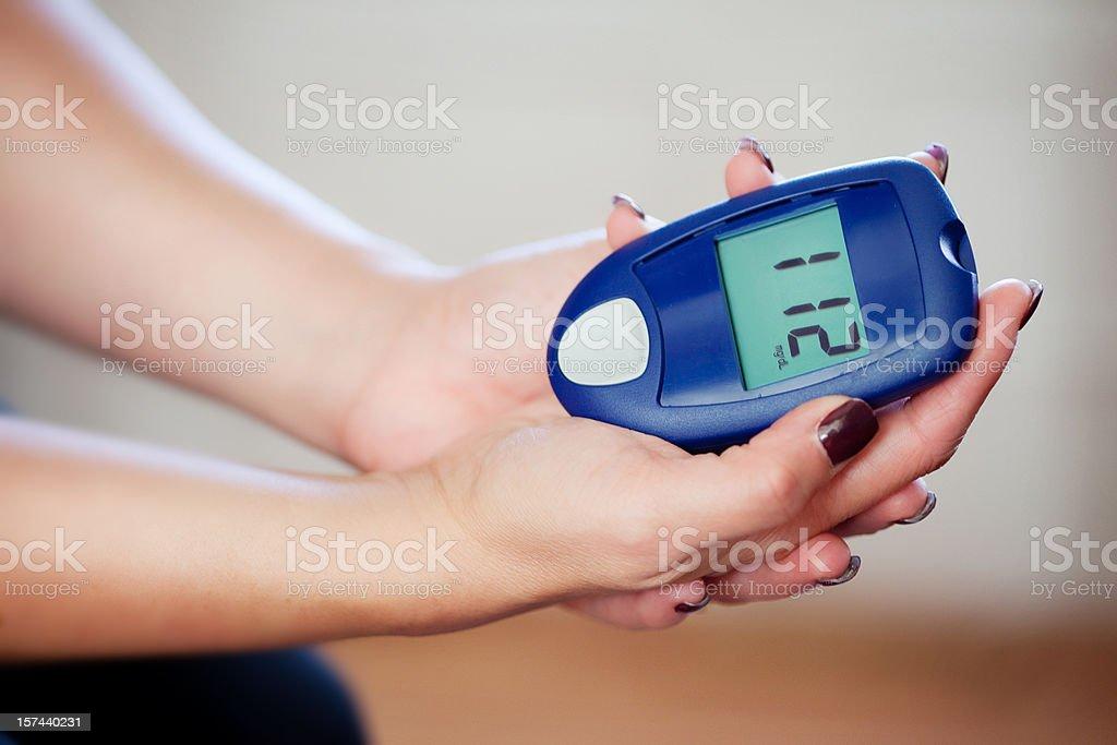 Testing Blood Sugar at home stock photo
