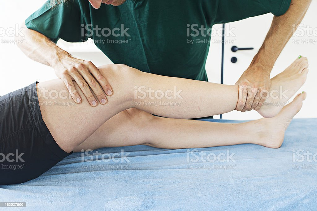 Testing extension of a knee stock photo