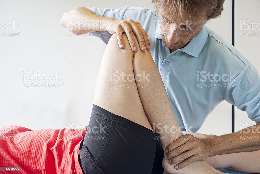 Testing flexibility of a knee royalty-free stock photo