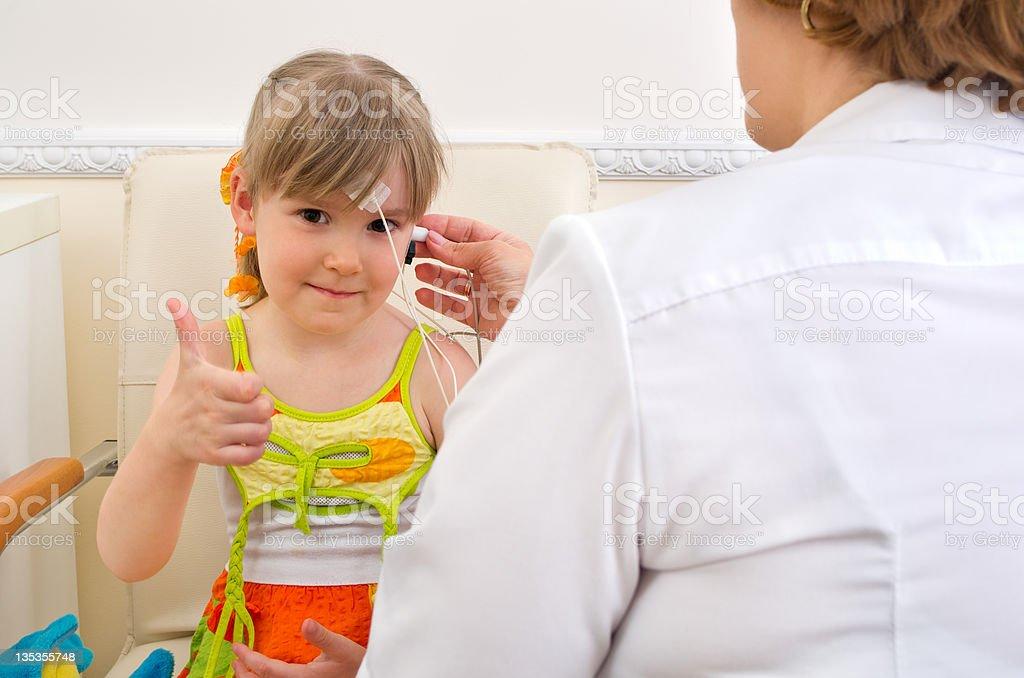 testing girl's ears stock photo