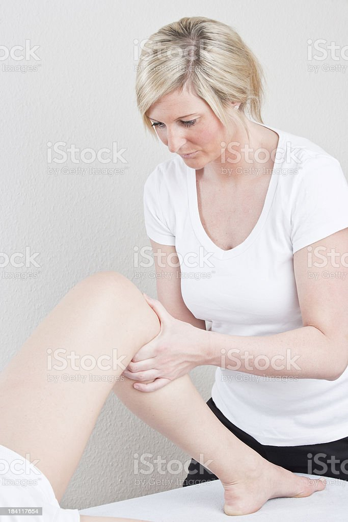 Testing knee for stability stock photo