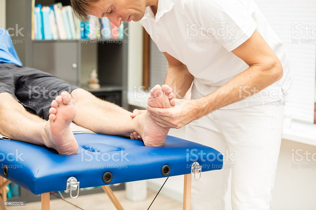 Testing mobility of foot. stock photo