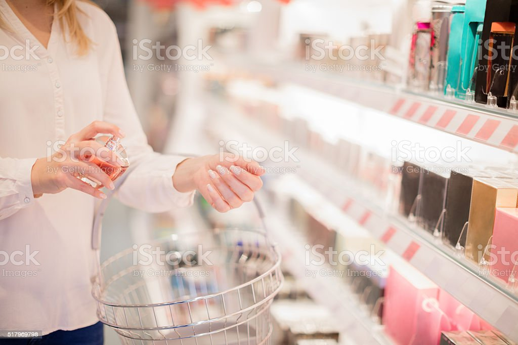 Testing parfume in store stock photo