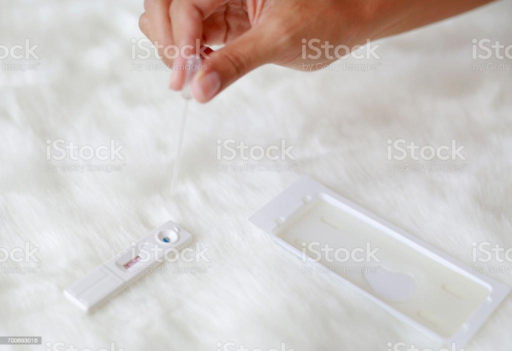 Testing pregnancy on artificial white fur background. stock photo